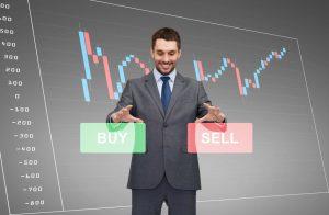 businessman or stock broker over forex chart