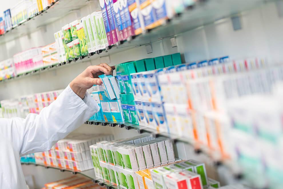 Shelves_hand_taking_medicine.jpg
