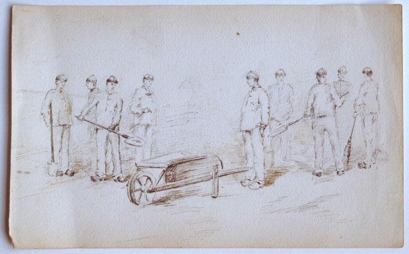 Groupe de neuf fossoyeurs autour d'une brouette