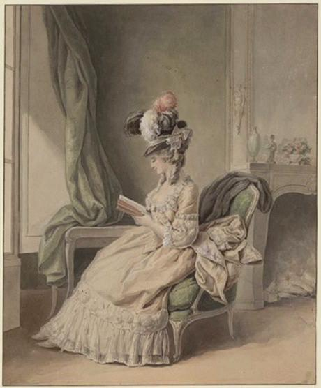 Une femme lisant près d'une fenêtre