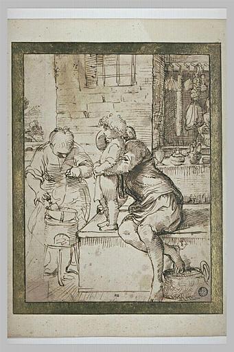 Une femme faisant la cuisine, regardée par un homme tenant un enfant