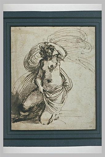 Une femme à genoux, à demi nue