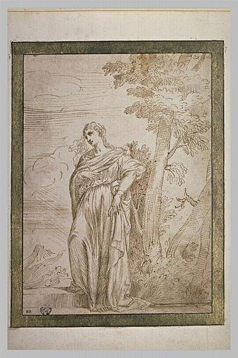 Une femme, debout au pied d'un arbre, tenant une croix dans la main droite