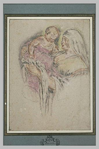Femme tenant un enfant dans les bras