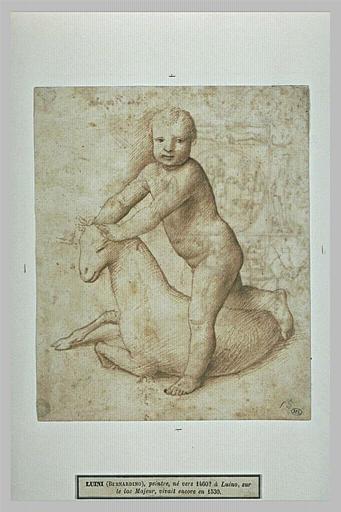 Enfant jouant avec un agneau