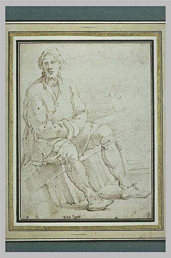 Homme assis, les bras croisés, sur le bord d'une barque