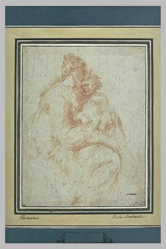 Une femme assise avec un enfant sur les genoux_0