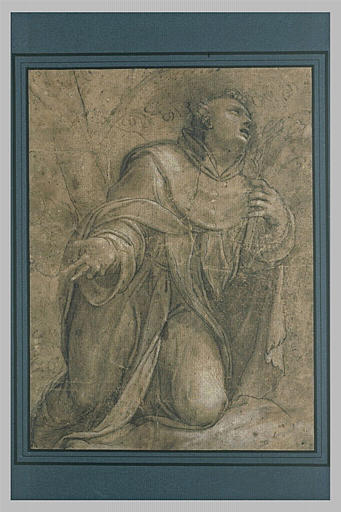 Saint Dominique en prières tenant un crucifix