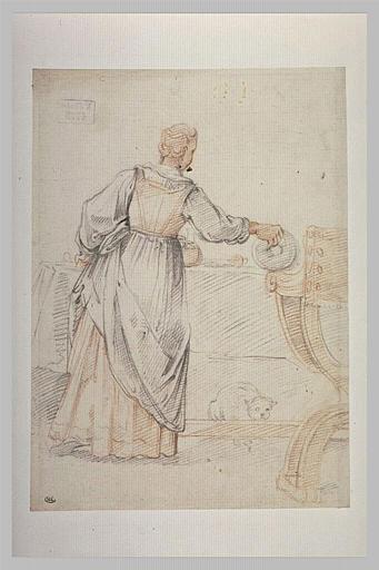 Femme, vue de dos, dressant le couvert