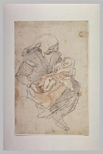 Femme assise tenant un enfant sur les genoux