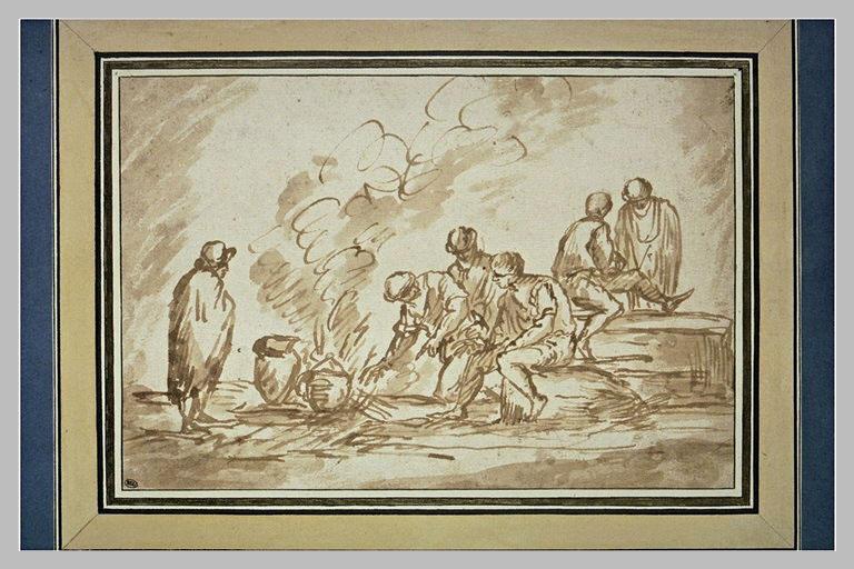 Groupe d'hommes cuisinant en plein air