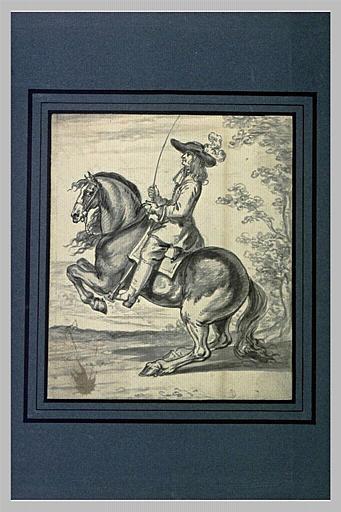 Un cavalier une cravache à la main, son cheval se cabre_0