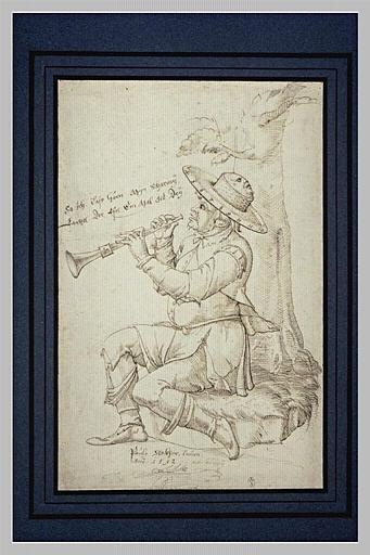 Homme assis près d'un arbre jouant de la clarinette