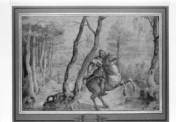 Cavalier sur un cheval qui se cabre, dans une région boisée