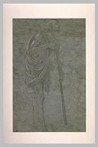 Homme debout, s'appuyant sur un bâton pour marcher