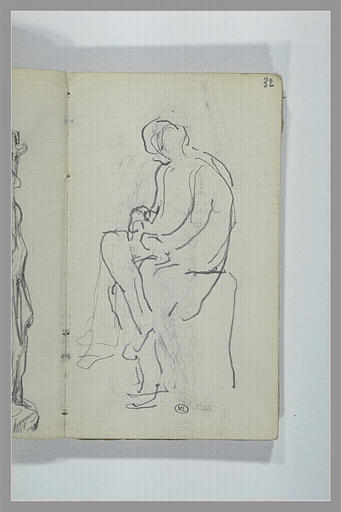 Une figure assise sur un socle