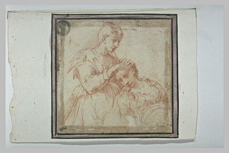 Une femme peignant une autre femme