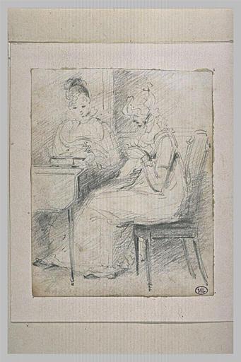 Laura et Lydia assises devant une table