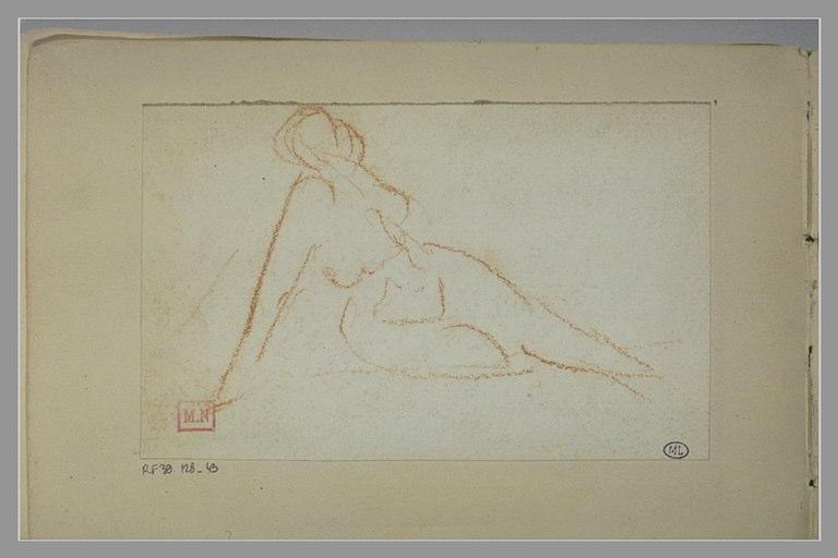 Une femme nue, étendue par terre