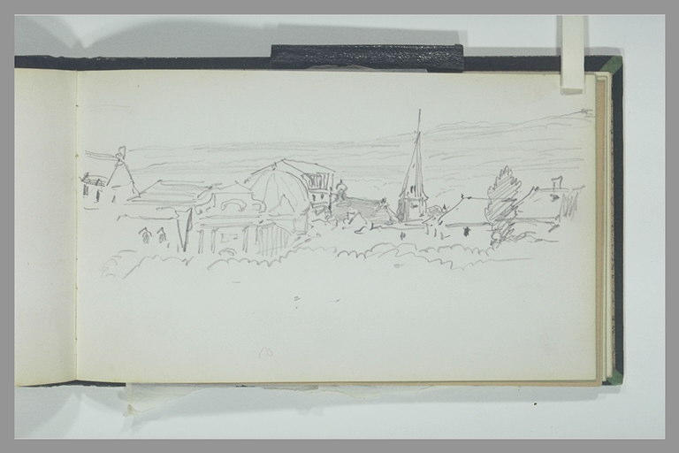 Vue des toits d'une ville avec un clocher
