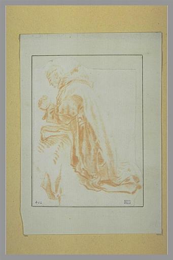 Moine agenouillé en prières, vu de profil