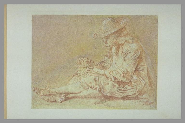 WATTEAU Antoine (d'après), anonyme : Homme assis à terre, de profil vers la gauche, un brin d'herbe dans la main