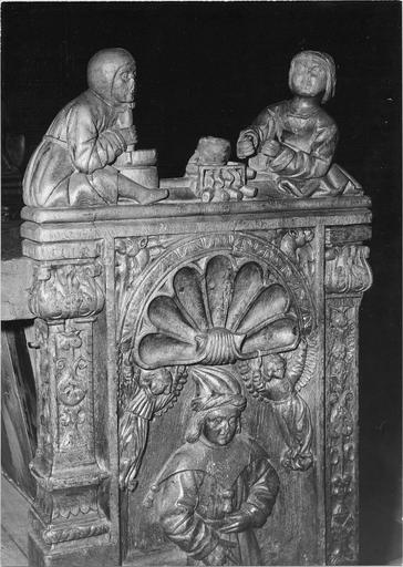 Stalles du choeur, bois sculté, 1512, détail du décor sculpté, deux personnages face à face