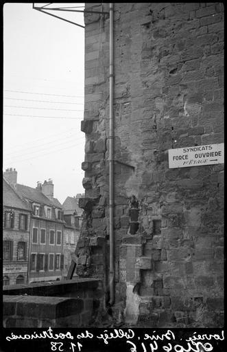 Détail d'un mur en pierre sur rue