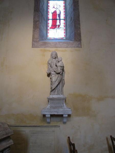 quatre statues (statuettes) : Christ enfant tenant la croix, Vierge à l'Enfant, Saint évêque et Saint diacre