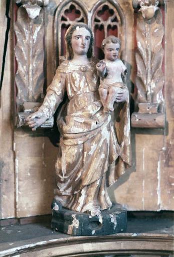 Tabernacle sur le maître-autel, contenant sept statues de saints personnages , bois peint et doré, 18e siècle, détail d'une statuette représentant une Vierge à l'Enfant