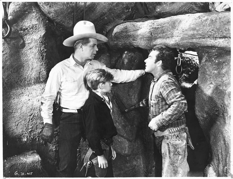 Bob Merril (H. Gibson) avec un enfant