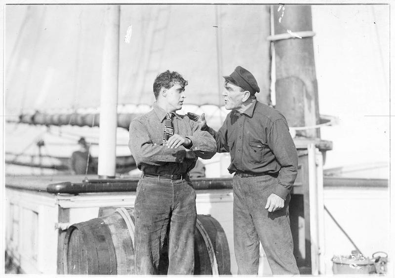 Shark Rawley (G. Walsh) discutant sur le pont du bateau