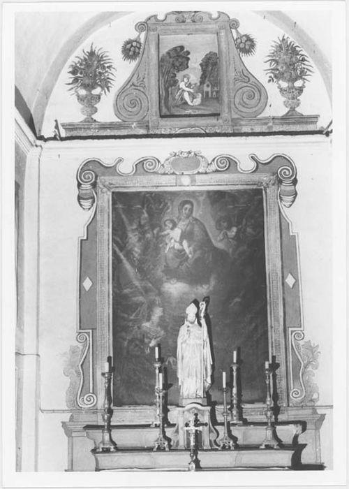 autel, retable et tableau : la Vierge entourée de saint Jean-Baptiste, sainte Lucie et un autre saint, vue générale