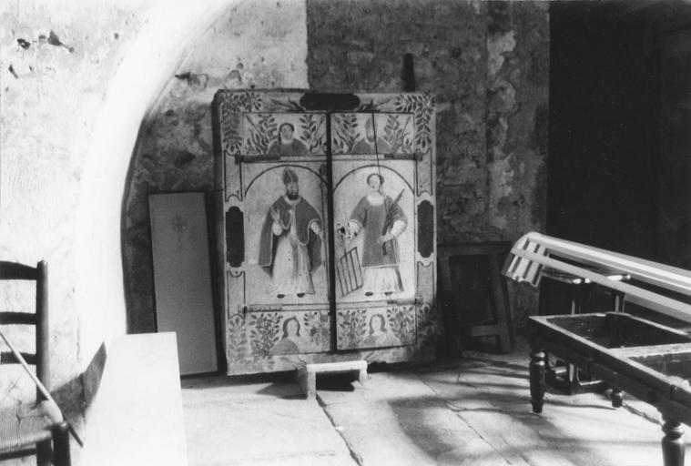 Armoire de sacristie aux vantaux peints des figures de saint Lizier et saint Laurent, bois taillé, peint