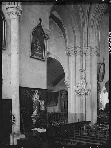 Intérieur : la nef et le bas-côté, statue du Christ