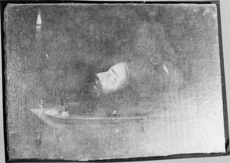 tableau : tête de saint Jean-Baptiste sur un plateau éclairée par une chandelle