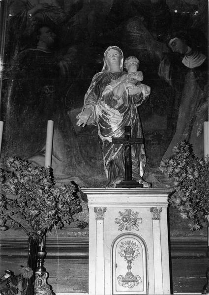 Autel, gradins, tabernacle, retable et sa toile : la Donation du Rosaire