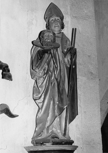 statue : Saint Grat, cephalophore (chef de saint Jean-Baptiste) avec un baton dans la main gauche, bois polychrome