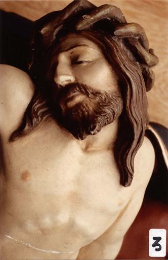 groupe sculpté : Vierge de Pitié, détail du visage du Christ, bois polychrome, 16e siècle, après restauration, 1983