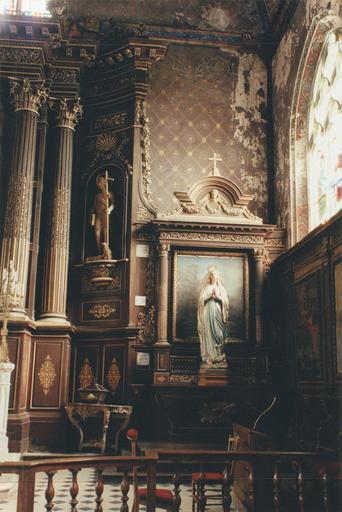 retable latéral et statue de la Vierge