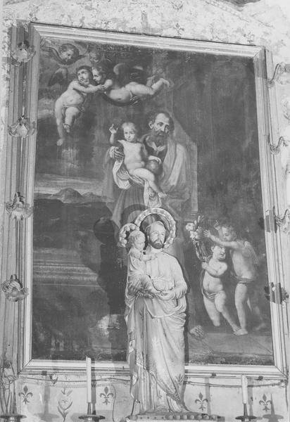 Tableau : saint Joseph et l'enfant Jésus entourés d'angelots