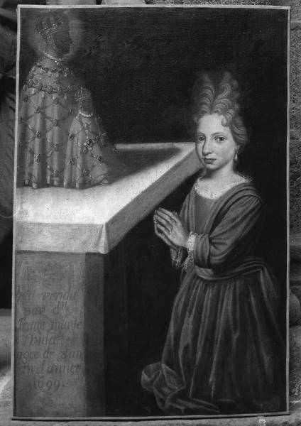 tableau votif : Jeanne Marie Vidal agenouillée devant la Vierge noire du Puy