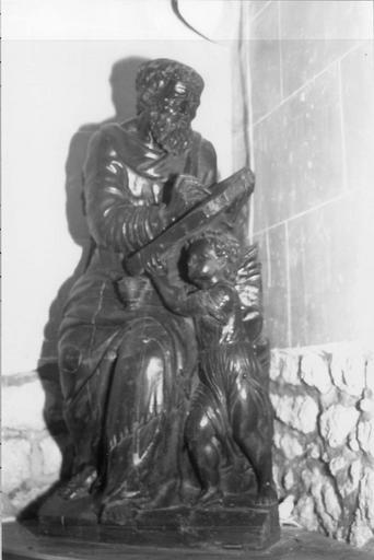 Statue : l'Evangéliste saint Matthieu écrivant sous la dictée de l'ange, bois sculpté, 17e siècle