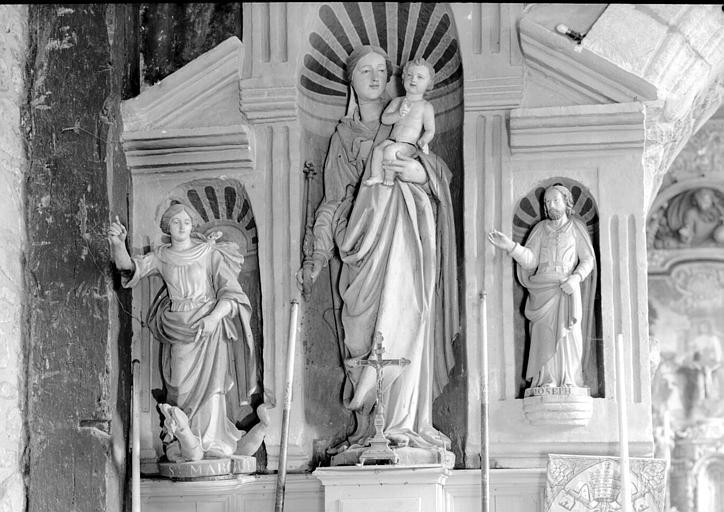 Trois statues en bois : Vierge à l'Enfant, sainte Marguerite, saint Joseph