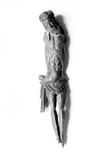 Salle des Consuls : Christ détaché de son support, bras manquants,  bois, émail champlevé du 12e siècle