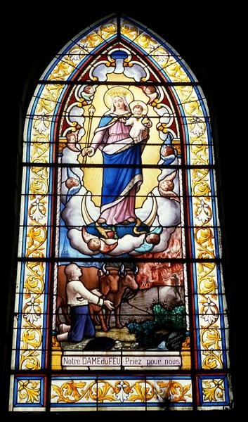 Verrière du mur sud de la nef : Notre-Dame du Feu
