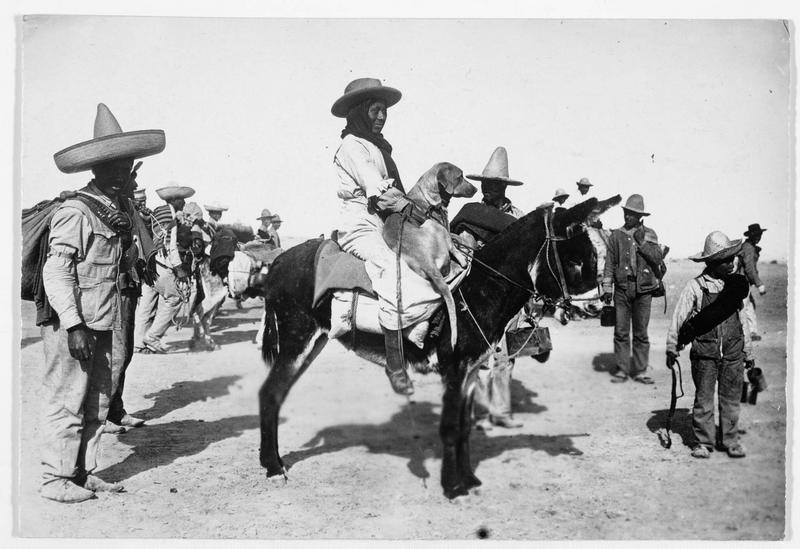 Mexicains avec leurs animaux domestiques, dans un camp américain