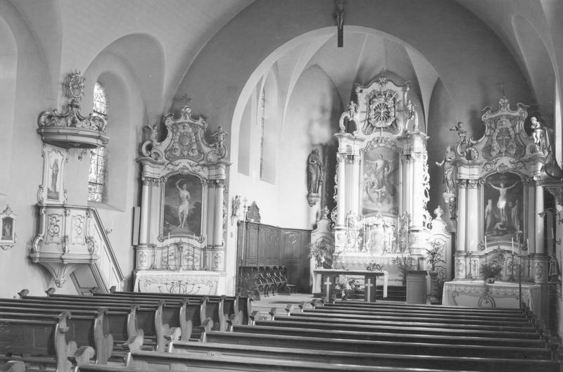autels (3), tabernacle, retables (3), lambris de revêtement, stalles, chaire à prêcher (maître-autel, autels secondaires) : Crucifixion, saint Sébastien, Assomption