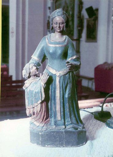 Groupe sculpté : sainte protectrice et un donateur