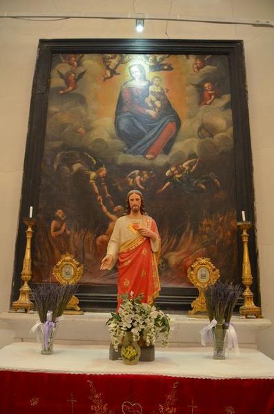 tableau et son cadre : la Vierge à l'enfant et les âmes du Purgatoire, vue générale